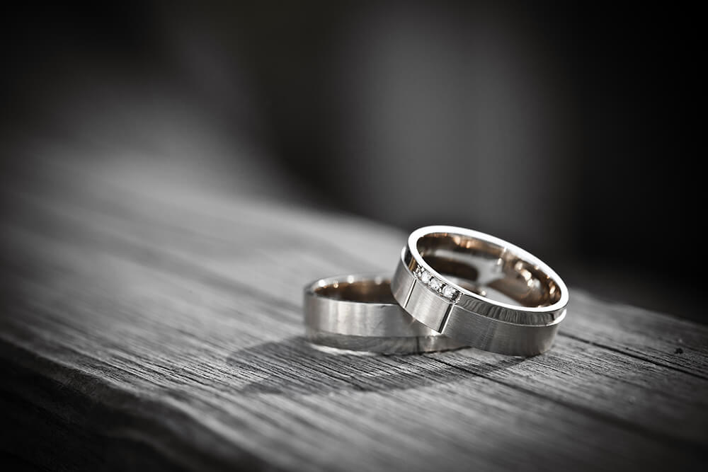 Wedding rings on bench